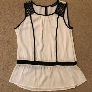 Beautiful top with cinched waist and lace accent
